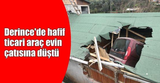 Derince'de hafif ticari araç evin çatısına düştü