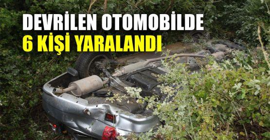 Devrilen otomobilde 6 kişi yaralandı