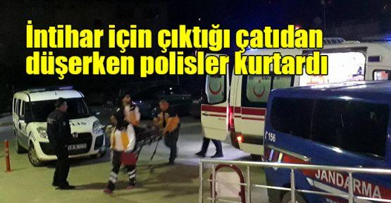 İntihar için çıktığı çatıdan düşerken polisler kurtardı