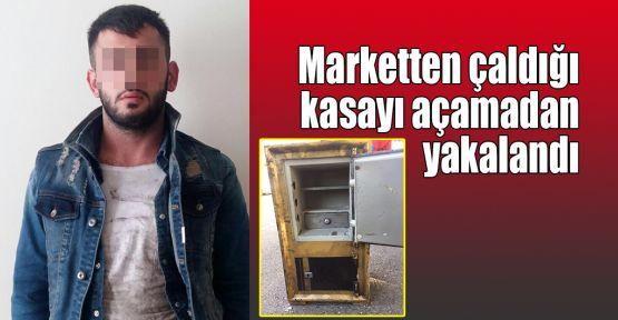 Marketten çaldığı kasayı açamadan yakalandı