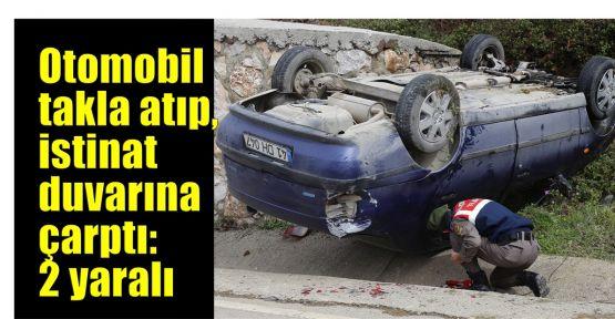 Otomobil takla atıp, istinat duvarına çarptı: 2 yaralı
