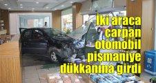 İki araca çarpan otomobil pişmaniye dükkanına girdi