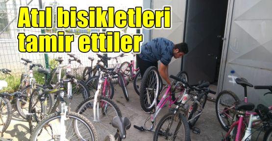 Atıl bisikletleri tamir ettiler