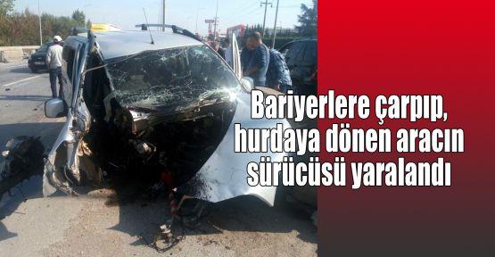 Bariyerlere çarpıp, hurdaya dönen aracın sürücüsü yaralandı