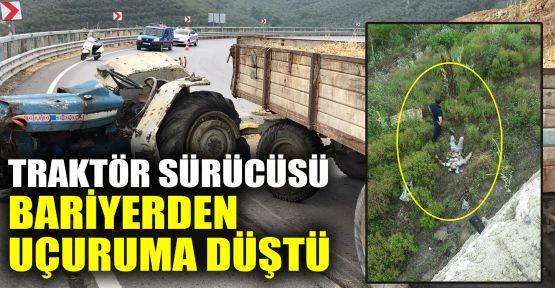 Kaza yapan traktör sürücüsü bariyeri aşıp uçuruma düştü
