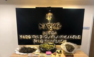 Bursa'da ağaçlık alanda uyuşturucu saklayan iki şüpheli tutuklandı