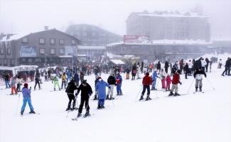 Uludağ'da yoğun sis tatilcilere engel olmadı