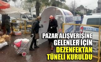 Kocaeli'de pazar alışverişine gelenler için dezenfektan tüneli kuruldu