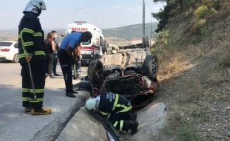 Kanala devrilen otomobilin sürücüsü yaralandı