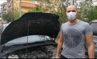 Kocaeli'de aracın motoruna sıkışan kedi ve yavrusu kurtarıldı