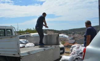 Ayvalık'ta ihtiyaç sahiplerine 15 ton kömür dağıtıldı